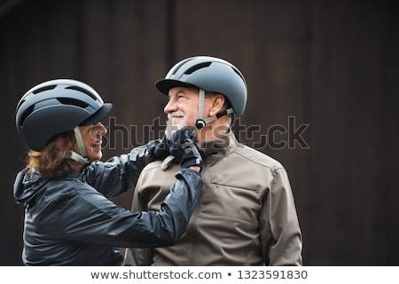 Senior man fastening cycle helmet Stock photo © IS2