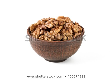 Walnuts shelled in a bowl isolated on white background. Side view. Walnut kernels in a bowl. Stock photo © ivo_13
