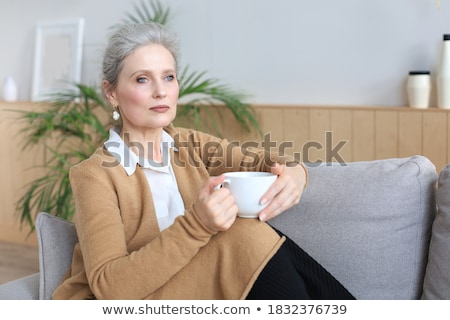 Mature woman drinking coffee Stock photo © IS2