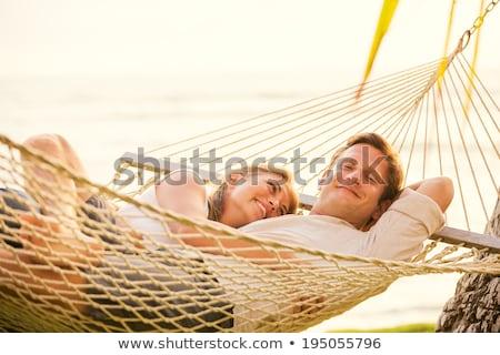 couple relaxing on hammock stock photo © is2