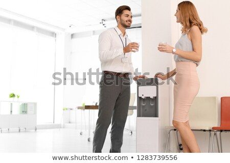 portrait of co workers by water cooler stock photo © is2