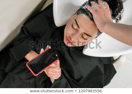 Female talking on phone at hairdressers Stock photo © IS2