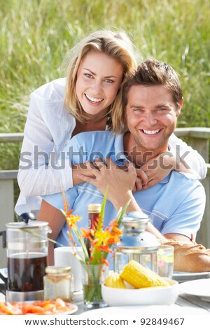 man and woman outside chalet Stock photo © IS2