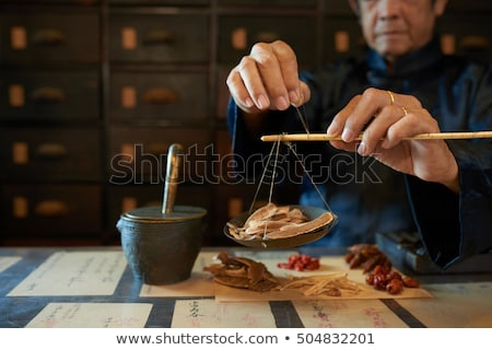 Hand of man and medicinal ingredients Stock photo © ssuaphoto