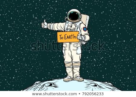 Astronaut hitch rides on Earth Stock photo © studiostoks