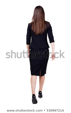 back view of a businesswoman walking and looking to side stock photo © feedough