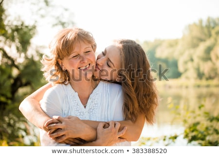 mother and daughter hugging stock photo © IS2