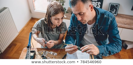 dochter · strijken · vrouw · familie · gelukkig · haren - stockfoto © is2