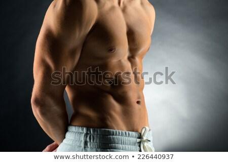 close up of male body or bare torso in gym stock photo © dolgachov