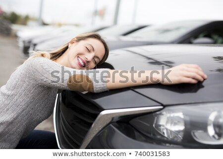 Stock photo: Girl proudly showing her key to a car