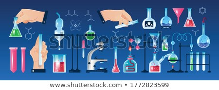 a scientist holding laboratory beaker stock photo © bluering