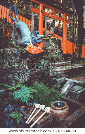 Fox purification fountain at Fushimi Inari Taisha, Kyoto, Japan Stock photo © daboost