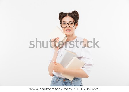Photo of beautiful teenage girl 20s with double buns hairstyle a Stock photo © deandrobot