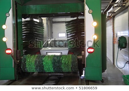 Brush turning in car wash with vehicle in it Stock photo © Kzenon