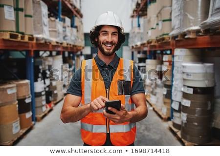 Zakenman helm smartphone magazijn groothandel business Stockfoto © dolgachov