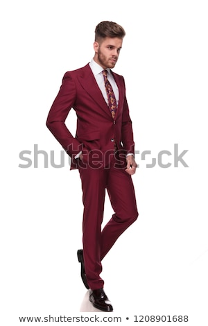 handsome man in grena suit steps and looks to side stock photo © feedough