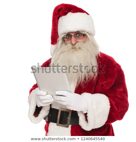 portrait of saint nick holding a grey tablet Stock photo © feedough