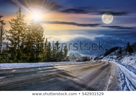 Curving road through snow covered hills Stock photo © lovleah