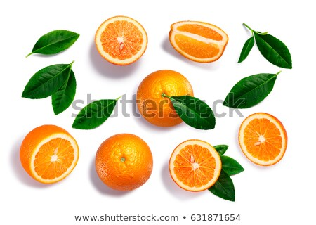 Oranges, whole, split, leaves, paths, top view Stock photo © maxsol7
