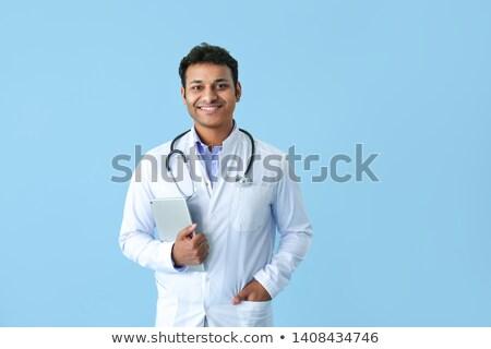 mosolyog · háziorvos · ír · orvosi · lemez · férfi - stock fotó © elnur