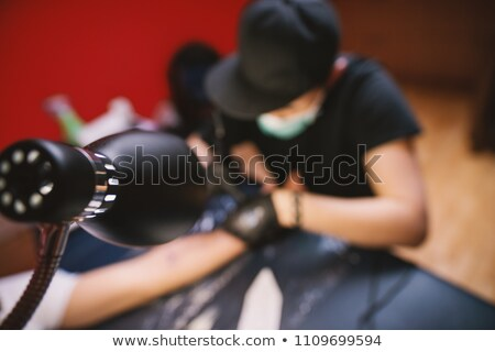 uomo · tattoo · braccio · guardare - foto d'archivio © ruslanshramko