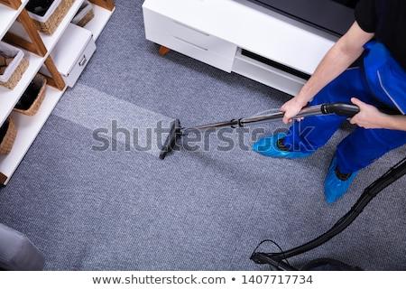 Gondnok takarítás padló porszívó boldog fiatal Stock fotó © AndreyPopov
