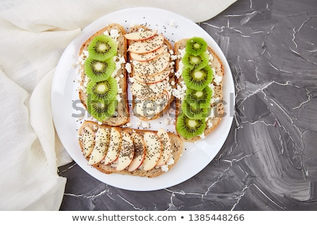 Healthy breakfast toasts with kiwi, apple, cottage cheese and chia seeds  stock photo © Illia