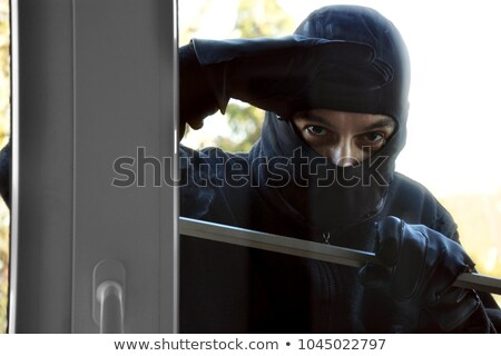 Burglar Looking Into A House Window Stock photo © AndreyPopov