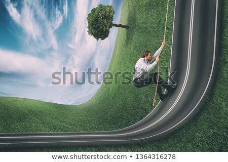 Businessman climbs a road bent upwards. Achievement business goal and difficult career concept Stock photo © alphaspirit