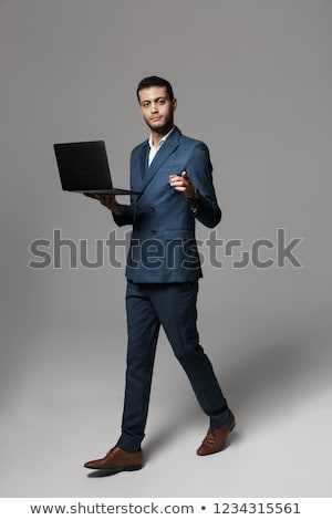 full length image of attractive arabic businessman 30s in formal stock photo © deandrobot