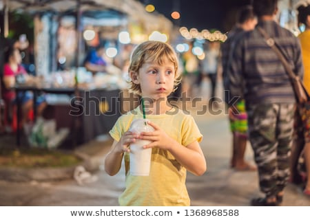 Boy tourist on Walking street Asian food market ストックフォト © galitskaya