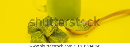 Green tea latte with ice in mason jar and straw on yellow background. Homemade Iced Matcha Latte Tea Stock fotó © galitskaya