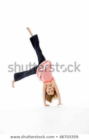 Young Girl In Gymnastic Pose Doing Cartwheel Stock photo © monkey_business