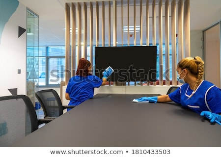 Two Young Janitor Cleaning The Office Stock photo © AndreyPopov