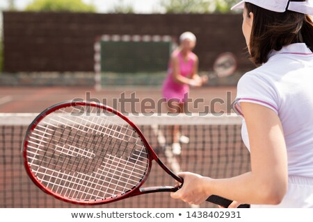 Young tennis player ready to catch ball Stock photo © pressmaster