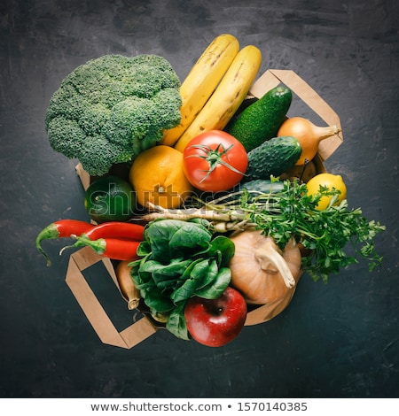 Stock photo: Paper bag of different health vegetables food