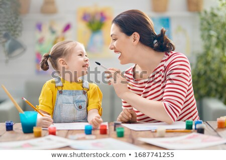 Children and play school teacher drawing together Stock photo © Kzenon