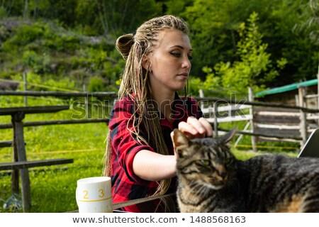 Jovem senhora cabeça felino companheiro vermelho Foto stock © Giulio_Fornasar