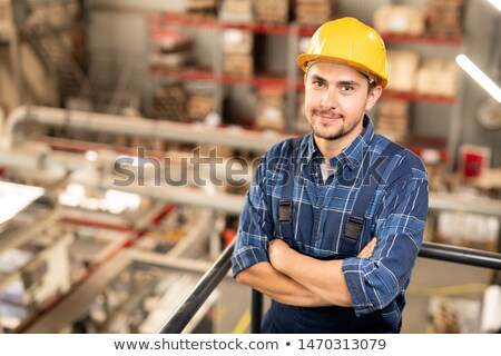 Young successful engineer in hardhat and uniform crossing his arms by chest Stock photo © pressmaster