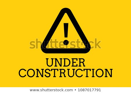 Under construction text with a warning sign against yellow background Stock photo © wavebreak_media