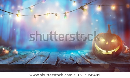 halloween design on table with string lights stock photo © mythja