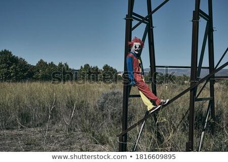 înfricoşător clovn abandonat panou colorat Imagine de stoc © nito
