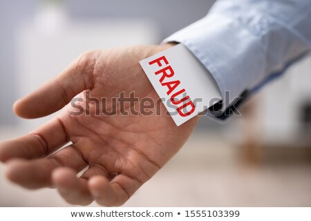 Zdjęcia stock: Businessperson Showing Fraud Card In His Sleeve