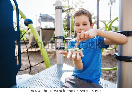 Finger spinner on the playground. Blurred background Stock photo © galitskaya