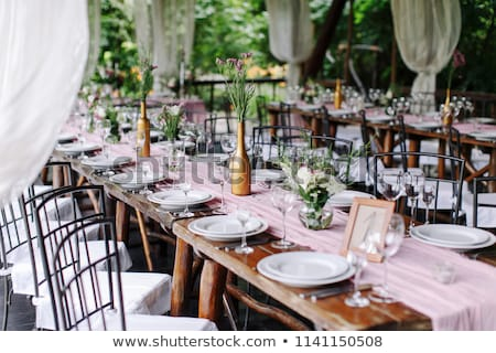on festive table in wedding banquet. the table is decorated with compositions of greenery Stock photo © ruslanshramko