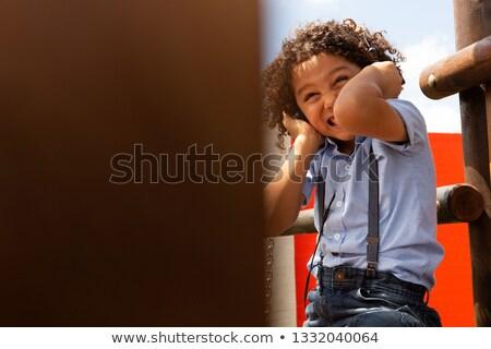 Front widoku uczennica słuchania głośno muzyki Zdjęcia stock © wavebreak_media