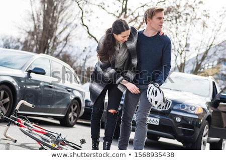 Сток-фото: Reliable Young Man Helping An Injured Woman While Waiting For The Ambulance