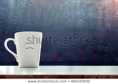 Mavi kupa üzücü yüz Stok fotoğraf © nito