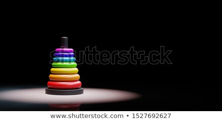 Stack of Rings in Ascending Order Spotlighted on Black Background Stock photo © make