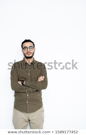 Young serious mixed-race businessman in casualwear looking at you in isolation Stock photo © pressmaster